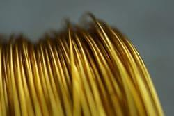 Electrical background. Rolled yellow wire